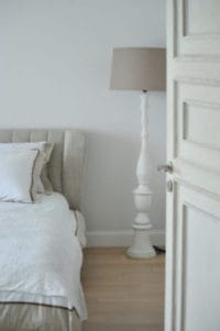 bed lamp and open door in a boardprep recovery residence